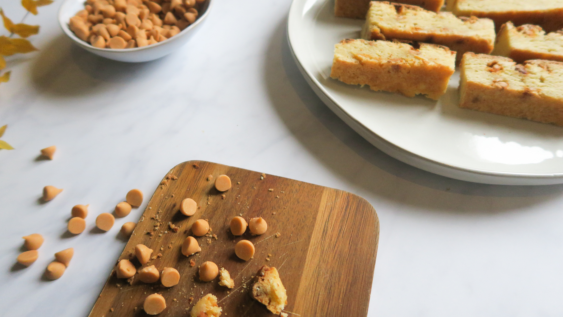 Butterscotch drops on a wooden plate