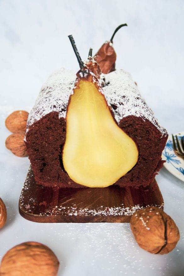 sliced chocolate cake with baked pear