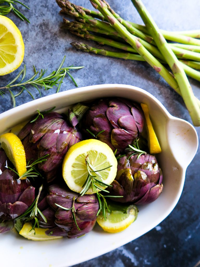 Artichokes with lemon and rosemary and garlic